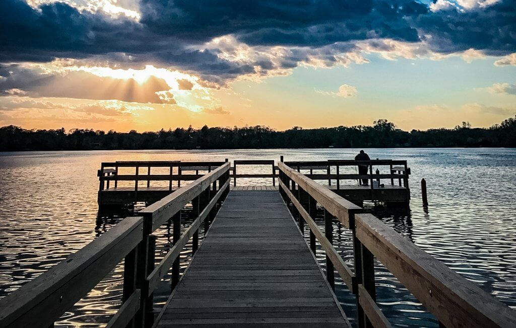 Pier on lake with sunset