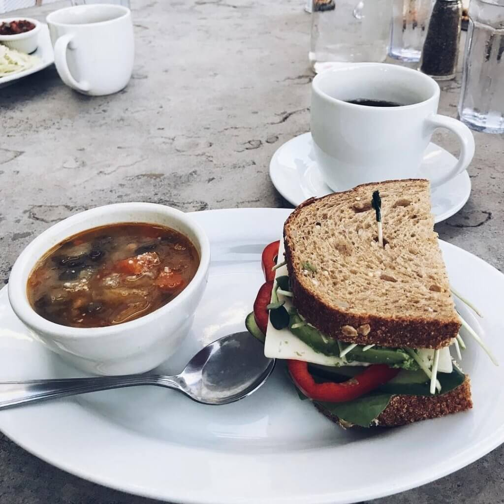 soup and sandwich on plate with coffee