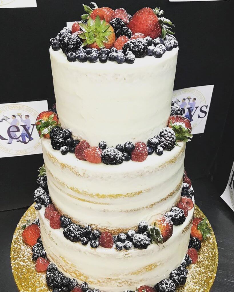 Three tier cake with berries on top