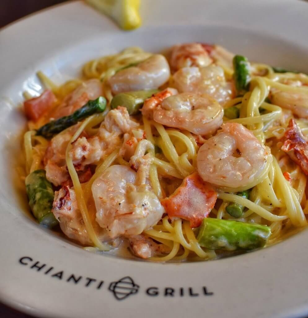 shrimp and lobster linguine with asparagus  in a chianti grill bowl
